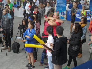 Hugs at the finish line of Hanoi Half Marathon